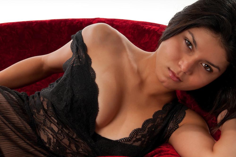 Hot latin girl in lingerie resting in sofa very sexy.