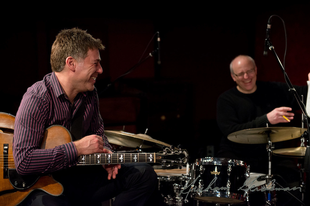 Guitarist Peter Bernstein shares a laugh with drummer Chris Brown