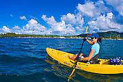 Woman kayaking on Hanalei Bay, Island of Kauai, Hawaii USA