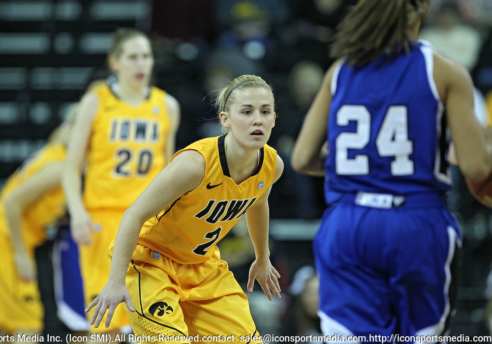 December 20, 2011: Iowa Hawkeyes guard Kamille Wahlin (2) watches as Drake Bulldogs guard Brittnye McSparron (24) brings the ball down court during the NCAA women's basketball game between the Drake Bulldogs and the Iowa Hawkeyes at Carver-Hawkeye Arena in Iowa City, Iowa on Tuesday, December 20, 2011. Iowa defeated Drake 71-46.