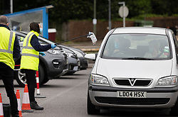© Licensed to London News Pictures. 19/06/2021. Tattenham Corner, UK. A PCR test is collected from a driver at a mobile covid-19 test centre at Tattenham Corner, Surrey. Surge testing for the coronavirus is taking place in parts of Surrey after a rise in infections caused by the delta variant. Photo credit: Peter Macdiarmid/LNP