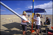 Amateur rocket launch. Registering to prepare for the Launch of a rocket during the annual Black Rock X amateur rocketry event in the Black Rock desert, Nevada, USA. This huge flat expanse of land is a popular launch site for large and powerful amateur rockets as it is far from civilization and has little natural animal or plant life.