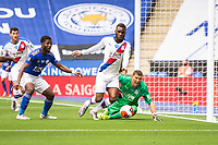 LEICESTER, ENGLAND - JULY 04: Christian Benteke of Crystal Palace clears the balll after Crystal Palace goalkeeper Vicente Guaita makes a save from Kelechi Iheanacho of Leicester City during the Premier League match between Leicester City and Crystal Palace at The King Power Stadium on July 4, 2020 in Leicester, United Kingdom. Football Stadiums around Europe remain empty due to the Coronavirus Pandemic as Government social distancing laws prohibit fans inside venues resulting in all fixtures being played behind closed doors. (Photo by MB Media)