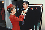 March 6, 2016 - NANCY REAGAN, Ronald Reagan's widow and First Lady from 1981-1989, has died at 94. The cause of death was congestive heart failure. Pictured: 1981 - The White House, Washington, District of Columbia, U.S. - U.S. President RONALD WILSON REAGAN is looked over by his wife First Lady NANCY DAVIS REAGAN, who is adjusting his tie.<br /> ©Michael Evans/Exclusivepix Media