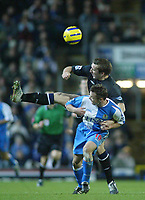 18/12/2004 - FA Barclays Premiership - Blackburn Rovers v Everton - Ewood Park<br />Blackburn Rovers' Paul Dickov is overpowered by Everton defender Alan Stubbs<br />Photo:Jed Leicester/Back Page Images