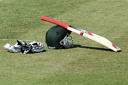 Gloves, bat and helmet on the pitch