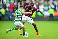 Kieran Tierney(#63) of Celtic FC tackles Clevid Dikamona (#28) of Heart of Midlothian during the Betfred League Cup semi-final match between Heart of Midlothian FC and Celtic FC at the BT Murrayfield Stadium, Edinburgh, Scotland on 28 October 2018.