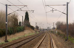View of railway track running through countryside,