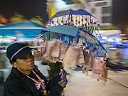03 JANUARY 2014 - BANGKOK, THAILAND: Anti-government protestors with Thai Baht tied to their umbrellas to symbolize government corruption march around Democracy Monument. Thousands of Thai anti-government protestors came to Democracy Monument in Bangkok Friday night to hear Suthep Thaugsuban, the leader of the protests, announce his plans to shut down the city of Bangkok. Suthep said his protestors would occupy 20 major intersections in the commercial sections of Bangkok for up to three weeks or until the caretaker government of Yingluck Shinawatra resigns.     PHOTO BY JACK KURTZ