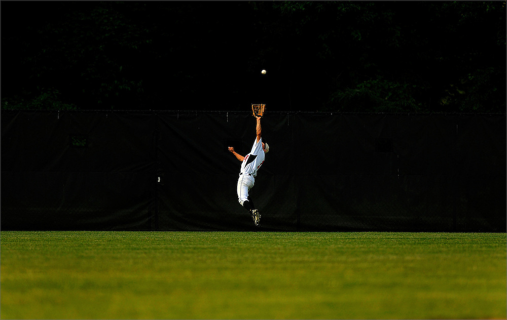 Jackson Memorial centerfielder Matt Meleo leaps to make the catch during the NJSIAA Group 4 Semifinal game against Washington Township held at Rider University in Lawrenceville on June 2.  The Jaguars went on to beat Washington Township by a score of 8-6.