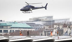 Tom Cruise (second left) walks along Blackfriars Bridge in London, during filming for Mission Impossible 6.