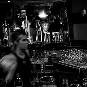 A bar patron spends his Saturday night at a pub in a Loyalist stronghold of  Londonderry. Northern Ireland, September 2019
