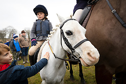 © Licensed to London News Pictures. 26/12/2018. London, UK.  A child on her pony at the traditional Chiddingfold, Leconfield and Cowdray Boxing Day Hunt sets off from the kennels at Petworth House in Petworth Park, West Sussex.  Photo credit: Vickie Flores/LNP