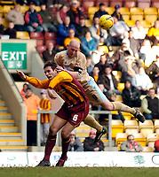 Photo: Jed Wee.<br />Bradford City v Bristol City. Coca Cola League 1. 18/02/2006.<br />Bristol's Steve Brooker (R) hitches a ride on the back of Bradford's Mark Bower.