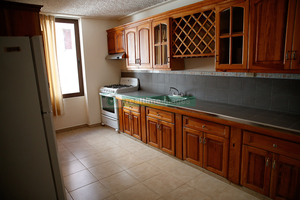 EXCLUSIVE: This is the luxury apartment complex in a run-down area of Port-au-Prince, Haiti, where a regional Oxfam director and aid workers are alleged to have exploited locals for sex after the 2010 earthquake in the poverty-stricken nation. 12 Feb 2018 Pictured: GV of the kitchen inside one of the apartments. Photo credit: MEGA TheMegaAgency.com +1 888 505 6342