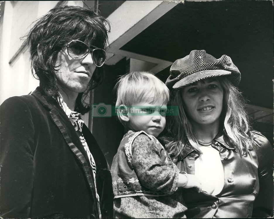 June 13, 2017 - FILE PHOTO - Italian-German actress and model ANITA PALLENBERG (born January 25, 1944 died June 13, 2017) has died at 73. A style icon and 'It Girl' of the 1960s and '70s, Pallenberg was credited as the muse of The Rolling Stones; she was the romantic partner of multi-instrumentalist and guitarist B. Jones, and later, from 1967 to 1980, the partner of Stones guitarist K. Richards, with whom she had three children. Pictured: Jun. 06, 1973 - Rolling Stone Star Keith Richard Faces Gun And Drug Charge: Following a raid by Scotland Yard's drug squad, Rolling Stone guitarist, Keith Richard, was arrested at his home in Cheyne Walk. Chelsea, London, today, and charged with illegal possession of are volver and ammunition and the drug cannabis. Also held in the raid was Richards German-born actress girl friend, Anita Pallenberg, and an actor friend Prince Jean Stanislas Klossowski. All three were bailed to appear at Marlborough Street Magistrates court tomorrow. Photo shows Keith Richards with girl friend, Anita Palenberg, and their son Marlon. (Credit Image: © Keystone Press Agency/Keystone USA via ZUMAPRESS.com)