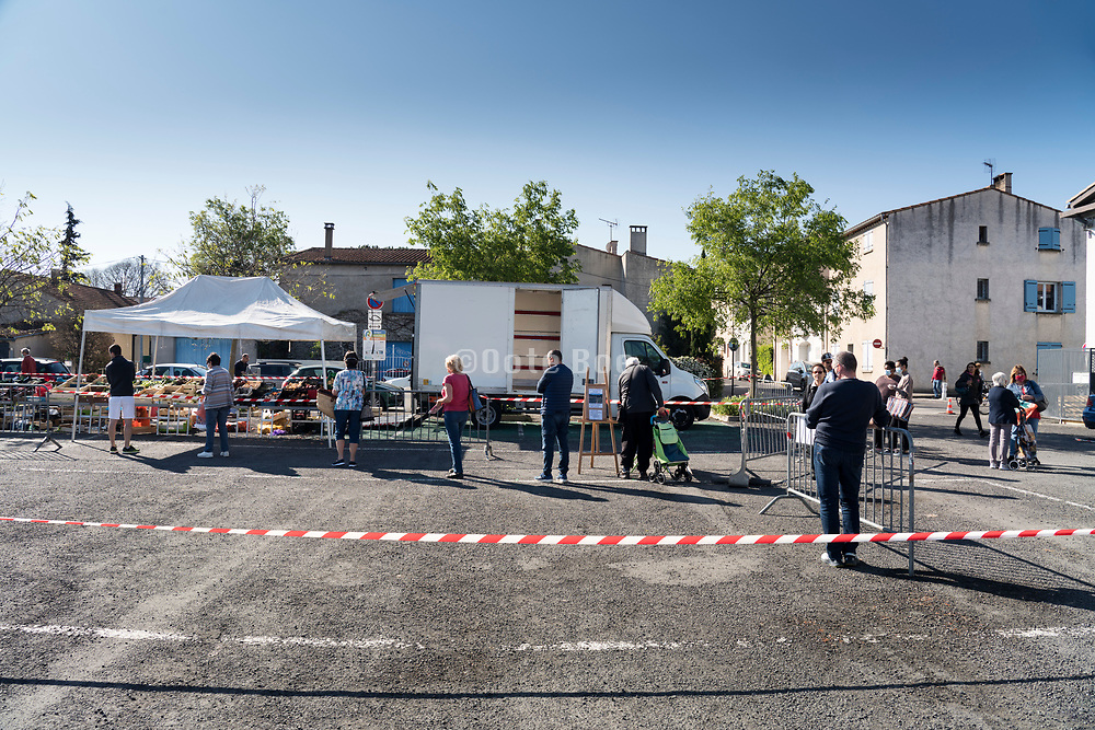 outdoors farmers market with crowd protection during the Covid 19 crisis Limoux France April 2020