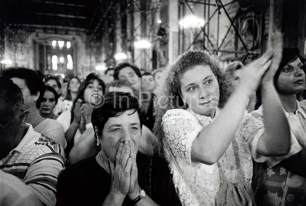 Crowd celebrates the miraculous liquification of St Genaro's blood which happens three times a year. A sample of the Saint's blood was saved after his execution by the emperor Diocietian who persecuted fellow Christians. The miracle of the liquificationis reputed to protect the population from unexpected lava bursts from Vesuvius.