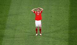 Russia's Artem Dzyuba celebrates scoring his side's third goal of the game during the FIFA World Cup 2018, Group A match at Saint Petersburg Stadium.