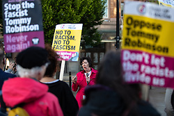 "© Licensed to London News Pictures . 26/05/2019. Manchester, UK. THERESA GRIFFIN MEP addresses a protest crowd of Stand up to Racism supporters , holding "" Oppose Tommy Robinson "" placards , who number approximately 25 . The count for seats in the constituency of North West England in the European Parliamentary election , at Manchester Central convention centre . Photo credit: Joel Goodman/LNP"