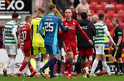 Aberdeen's Gary Woods (left) and Scott Brown shake hands after the cinch Premiership match at Pittodrie Stadium, Aberdeen. Picture date: Sunday October 3, 2021.