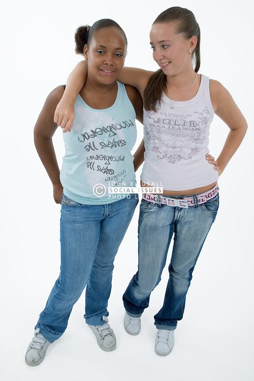 Two teenaged girls smiling,