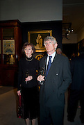 MR. AND MRS. RUPERT DANIELS, Preview party for the Versace Sale.  The contents of fashion designer Gianni Versace's villa on Lake Como. Sothebys. Old Bond St. London. 16 March 2009.  *** Local Caption *** -DO NOT ARCHIVE -Copyright Photograph by Dafydd Jones. 248 Clapham Rd. London SW9 0PZ. Tel 0207 820 0771. www.dafjones.com<br /> MR. AND MRS. RUPERT DANIELS, Preview party for the Versace Sale.  The contents of fashion designer Gianni Versace's villa on Lake Como. Sothebys. Old Bond St. London. 16 March 2009.