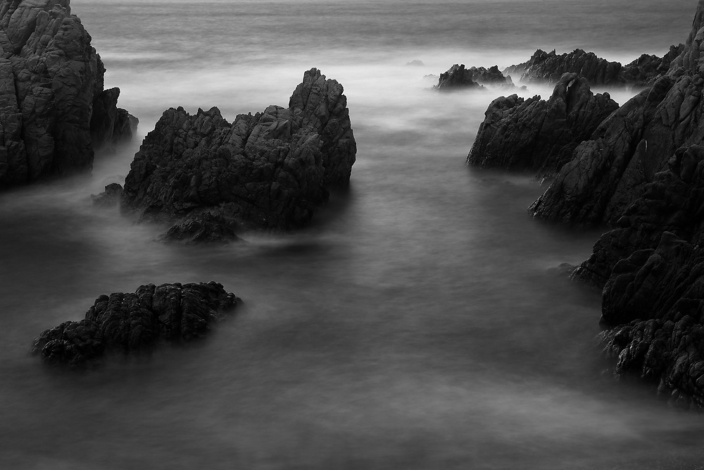 Monochrome long exposure image of the rocky coastine at Costa Paradiso, Sardinia
