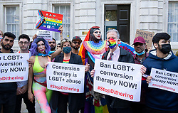 """LGBT+ protestors including Daniel Lismore, Jayne Ozanne, Rev Colin Coward and Peter Tatchell lead an anti Conversion Therapy demonstration outside The Cabinet Office, Whitehall, London, Great Britain<br /> 23rd June 2021<br /> <br /> Members of the LGBT+ community, including Peter Tatchell tell the Government to """"stop dithering"""" over its promised ban on LGBT+ conversion therapy. It pledged to outlaw conversion therapy practices in the UK in 2018. <br /> <br /> <br /> Photograph by Elliott Franks"""