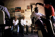 A local barber shop which cuts the hair of all the men folk of Anamoros village, El Salvador.