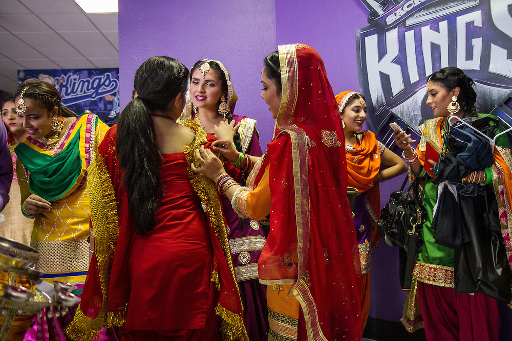 Sacramento, California: Dance troupe Majajana gets ready back stage before performing during halftime for Sikh Appreciation Night at the Sacramento Kings game, as part of the NBA franchise's outreach to its local community and the global Indian diaspora.