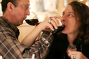Parmenter and Liana Welty drink wine with their arms intertwined at the Italian restaurant Buca di Beppo in Seattle, Washington.