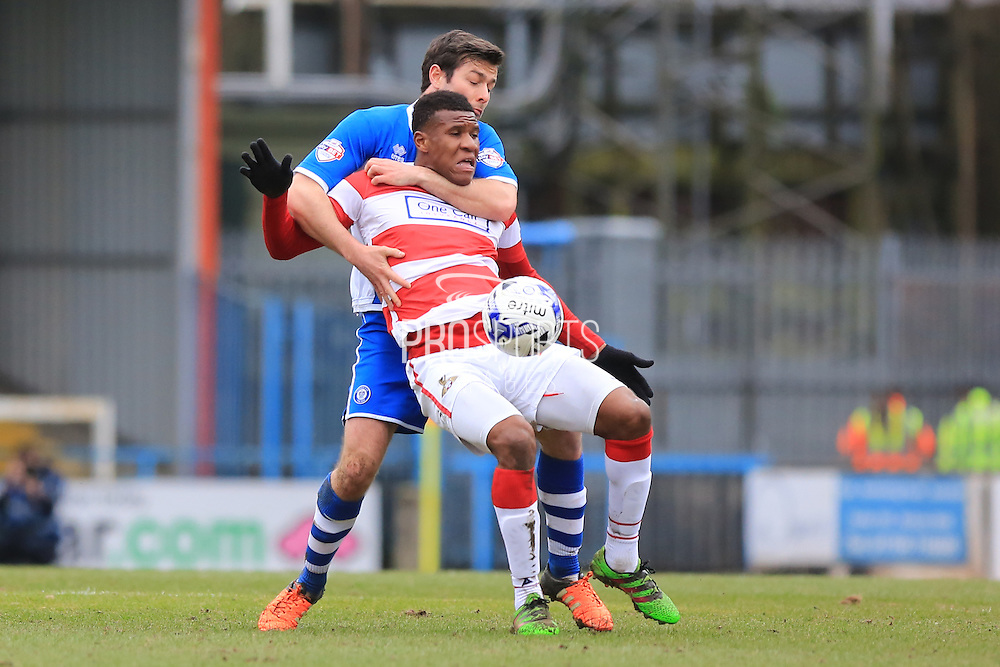Ricardo Calver challenged by Joe Rafferty during the Sky Bet League 1 match between Rochdale and Doncaster Rovers at Spotland, Rochdale, England on 2 April 2016. Photo by Daniel Youngs.