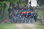 Montgomery, N.Y. - Members of the 124th New York State Volunteers advance on a Confederate  position during a Civil War reenactment at the Orange County Farmers Museum on Sept. 23, 2006.