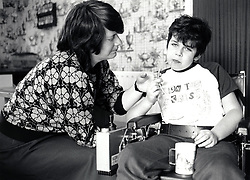Disabled boy with his mother, UK 1990