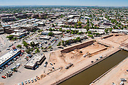 26 AUGUST 2005 - Construction at the Scottsdale Riverfront redevelopment project. Looking south into Old Town Scottsdale. Jay Kelso is operating the crane, which is about 300 feet above the base of the excavation. PHOTO BY JACK KURTZ