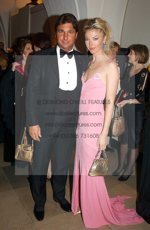 MISS TAMARA BECKWITH and MR GEORGE VERONI at a private dinner to unveil the Van Cleef & Arpels jewellery collection 'Couture' with fashion by Anouska Hempel Couture held at The Banqueting House, Whitehall Palace, London on 8th March 2005.<br /><br />NON EXCLUSIVE - WORLD RIGHTS