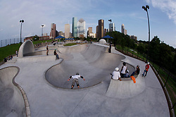 Group of kids skateboarding at the Lee & Jo Jamail skatepark on the outskirts of downtown Houston