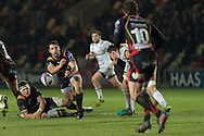 Charlie Davies of the Newport Gwent Dragons passes the ball at speed to his team mate Nick Macleod as Ed Jackson on the floor looking on. European Challenge cup pool 3 match, Newport Gwent Dragons v Brive, at Rodney Parade in Newport, South Wales on Friday 14th October 2016.<br /> pic by  Simon Latham, Andrew Orchard sports photography.