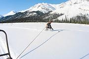 Alaska , Brooks Range. Iniakuk Lake Lodge. Sking off the back of a snowmachine.