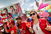 10 MAY 2014 - BANGKOK, THAILAND: Supporters of Yingluck Shinawatra cheer at a Red Shirt rally in Bangkok. Thousands of Thai Red Shirts, members of the United Front for Democracy Against Dictatorship (UDD), members of the ruling Pheu Thai party and supporters of the government of ousted Prime Minister Yingluck Shinawatra are rallying on Aksa Road in the Bangkok suburbs. The government was ousted by a court ruling earlier in the week that deposed Yingluck because the judges said she acted unconstitutionally in a personnel matter early in her administration. Thailand now has no functioning government. Red Shirt leaders said at the rally Saturday that any attempt to impose an unelected government on Thailand could spark a civil war. This is the third consecutive popularly elected UDD supported government ousted by the courts in less than 10 years.    PHOTO BY JACK KURTZ