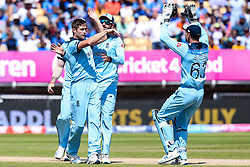Chris Woakes of England celebrateswith teammates after taking the wicket of K. L. Rahul of India - Mandatory by-line: Robbie Stephenson/JMP - 30/06/2019 - CRICKET - Edgbaston - Birmingham, England - England v India - ICC Cricket World Cup 2019 - Group Stage