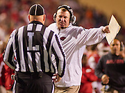 Arkansas razorback head coach Bret Bielema reacts to a call during an NCAA college football game against Auburn in Fayetteville, Ark., Saturday, Nov. 2, 2013. Auburn defeated Arkansas 35-17. (AP Photo/Beth Hall)