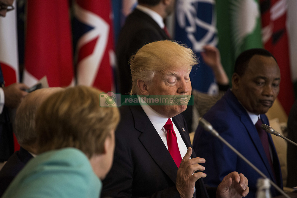 May 27, 2017 - Taormina, Sicily, Italy - U.S. President Donald Trump (R) talks to German Chancellor Angela Merkel (L) during the G7 Summit expanded session in Taormina, Sicily, on May 27, 2017. (Credit Image: © Christian Minelli/NurPhoto via ZUMA Press)