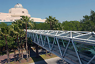 A walking bridge connects a parking garage with the Orlando Science Center, in the background, in Orlando, Florida.
