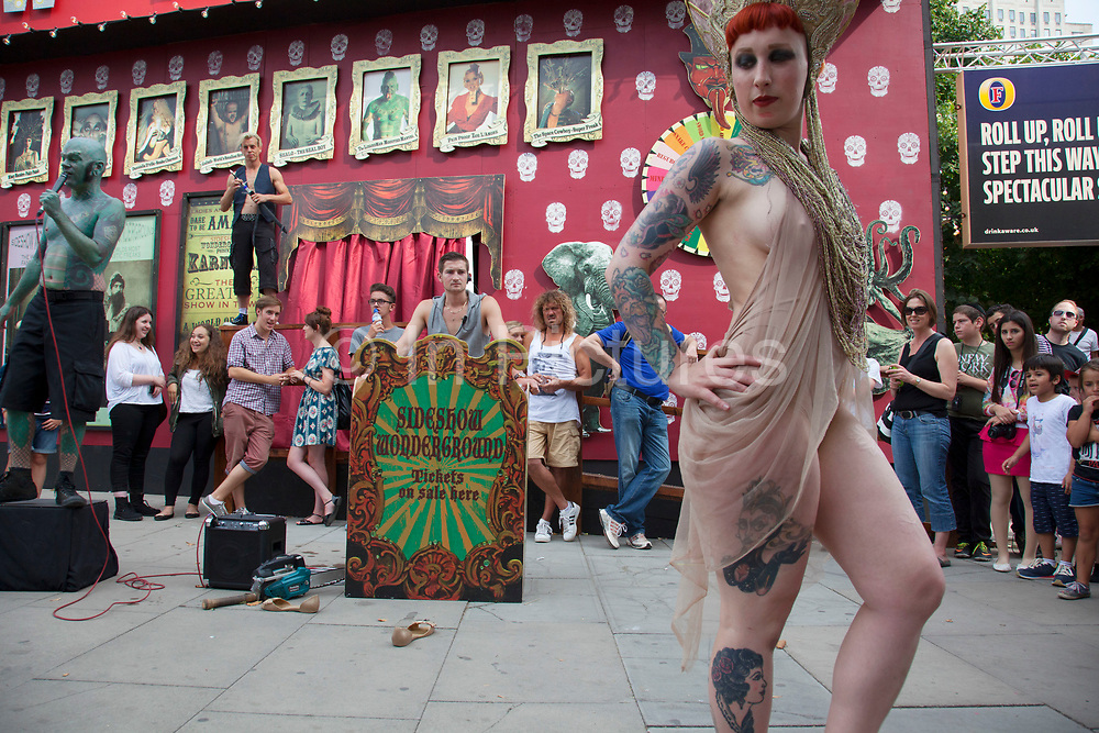 Members from the London Wonderground sideshow freakshow perform a free show to entice in customers. Missy Macabre performs her bed of nails act. The South Bank is a significant arts and entertainment district, and home to an endless list of activities for Londoners, visitors and tourists alike.