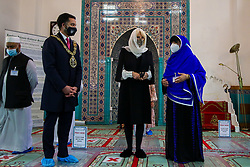 © Licensed to London News Pictures. 07/04/2021. London, UK. Camilla, Duchess of Cornwall, wearing a protective face covering and headscarf, and accompanied by Bibi Khan (R), President of the Mosque, is given an overview of the history of the Mosque and the work done to support the local community during Covid-19 lockdowns. The Mosque was formed by a small group of Guyanese Muslims and now supports over 30 different nationalities and community in Haringey and surrounding boroughs. Photo credit: Dinendra Haria/LNP