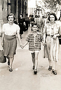 mother walking with son and a family friend France ca 1950s