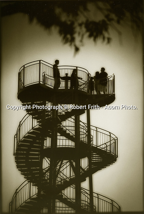 Family at the DNA Tower in Kings Park. Built on the highest point of the park in 1966, the DNA Tower is a white 15m high double helix staircase that has 101 steps and was inspired by a double staircase in the Château de Blois in France. Its design resembles the deoxyribonucleic acid (DNA) molecule. The paving below the DNA Tower is made with stones sent from 11 towns and 80 shires in Western Australia.