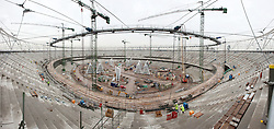 Olympic Stadium panorama. The cable net roof of the Olympic Stadium has been lifted into place. The cable net is formed between the outer white steel roof truss and an inner tension ring 30m above the field of play. Over 900t of scaffolding and over a kilometre of support platforms were used to assembled over 12,000m of cables and the walkways. It took six weeks and 56 hydraulic jacks to lift the 450t structure into place. Picture taken on 09 Dec 09 by Anthony Charlton.<br />